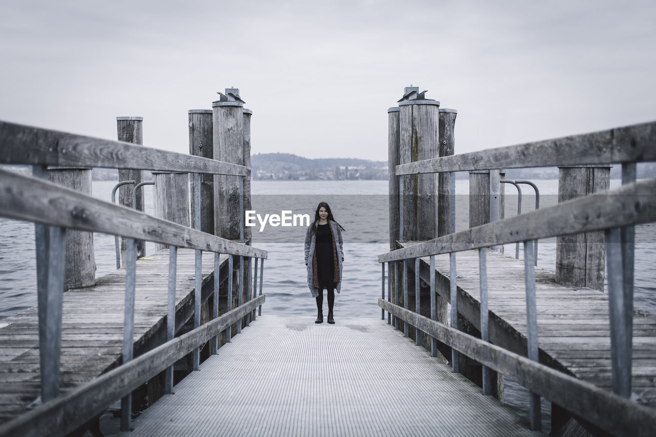Woman Standing On Pier