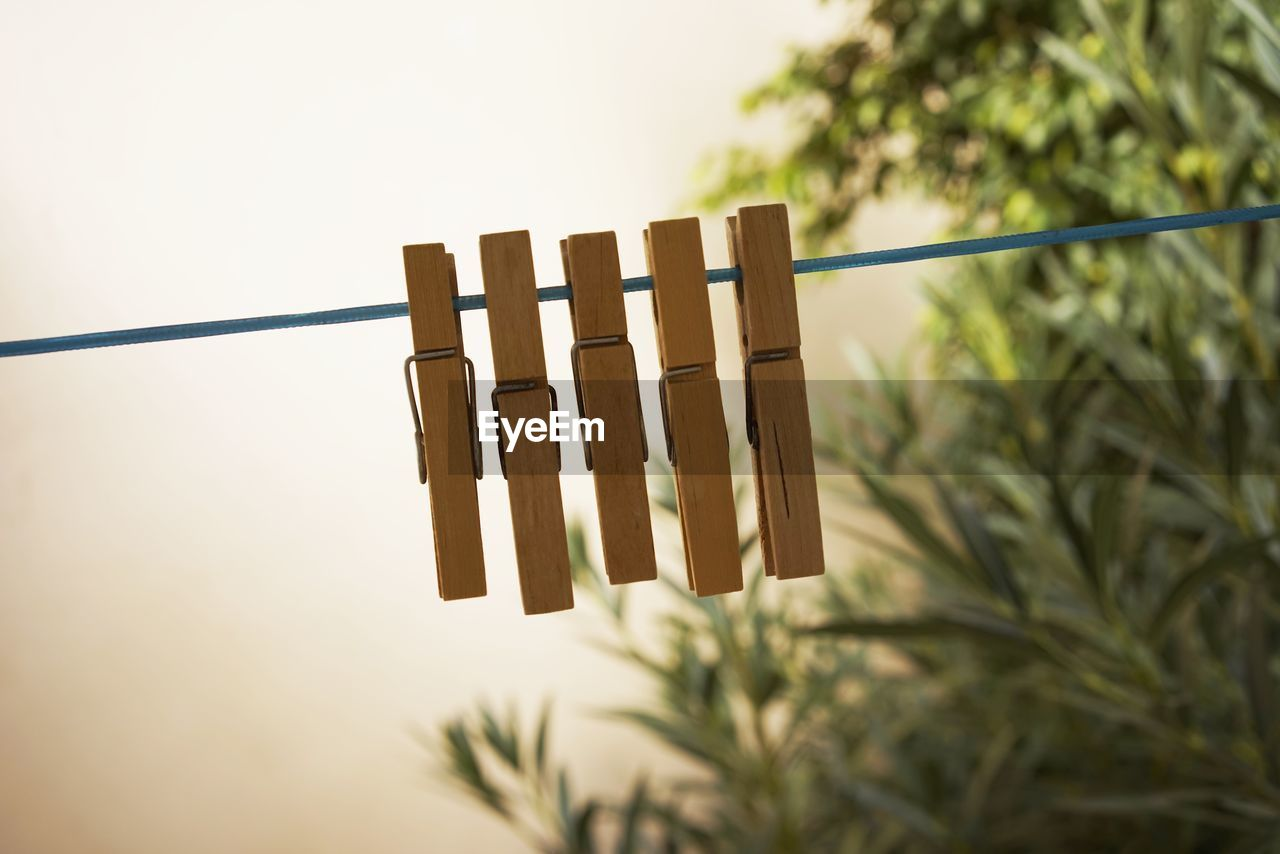 Clothespins On String During Sunset