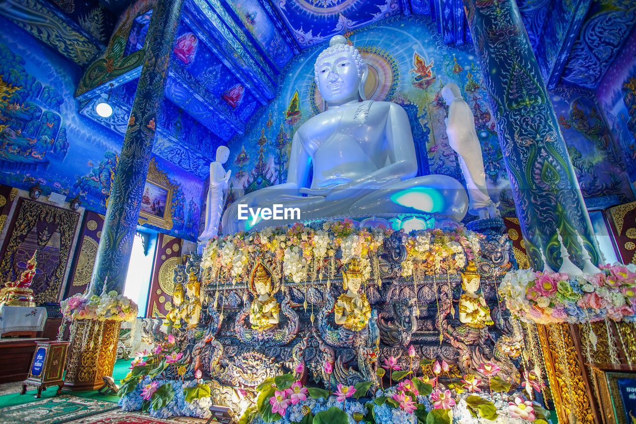 belief, religion, place of worship, spirituality, representation, art and craft, built structure, sculpture, architecture, low angle view, statue, human representation, building, creativity, indoors, male likeness, illuminated, no people, idol, ornate, ceiling