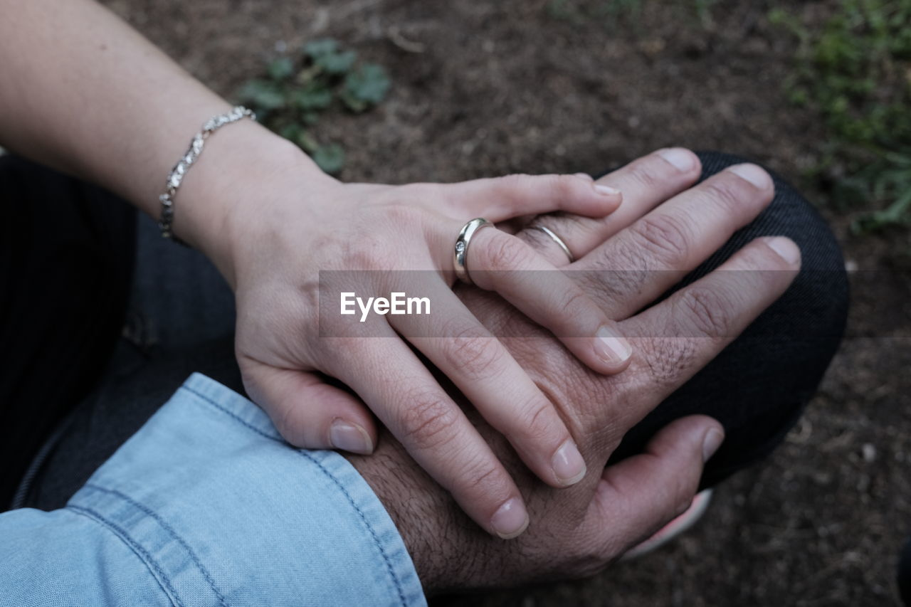 Close-Up Of Wife Holding Husband Hand