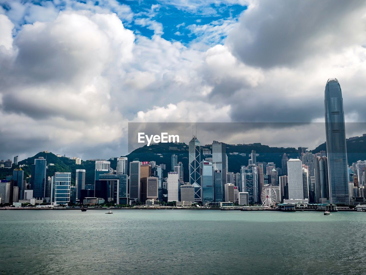 architecture, building exterior, built structure, cloud - sky, building, water, sky, city, waterfront, office building exterior, skyscraper, modern, nature, residential district, cityscape, landscape, sea, urban skyline, tall - high, no people, outdoors, financial district, bay, spire