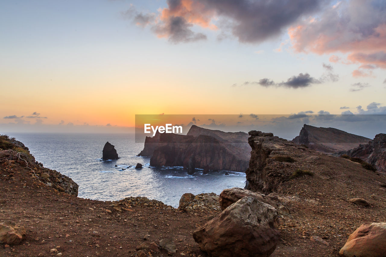 sky, rock, sunset, sea, water, beauty in nature, scenics - nature, solid, rock - object, tranquility, rock formation, tranquil scene, nature, cloud - sky, idyllic, beach, land, non-urban scene, no people, outdoors, horizon over water, stack rock, rocky coastline