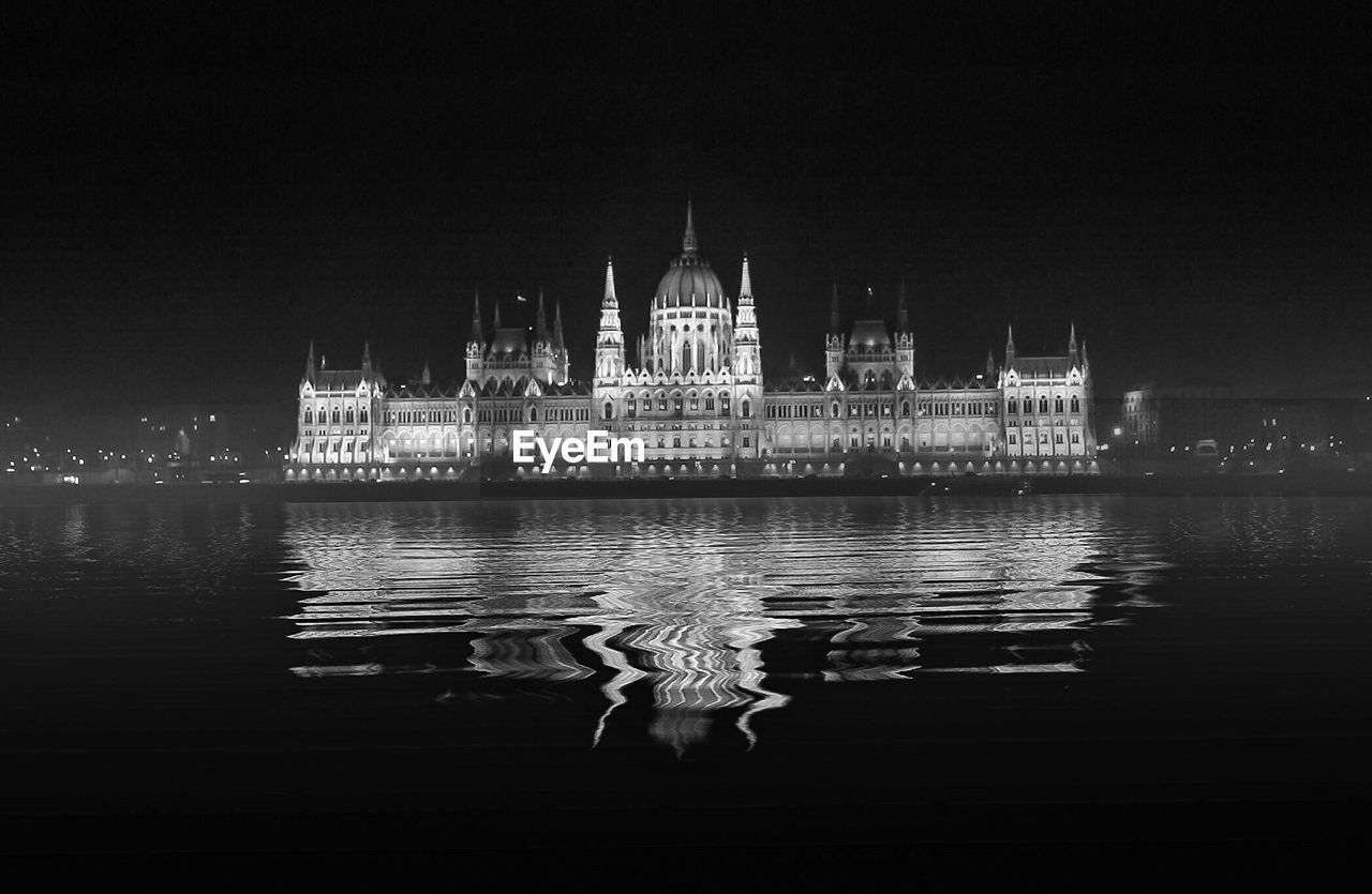 water, illuminated, architecture, building exterior, built structure, reflection, waterfront, night, travel destinations, sky, nature, travel, copy space, tourism, building, no people, river, city, government