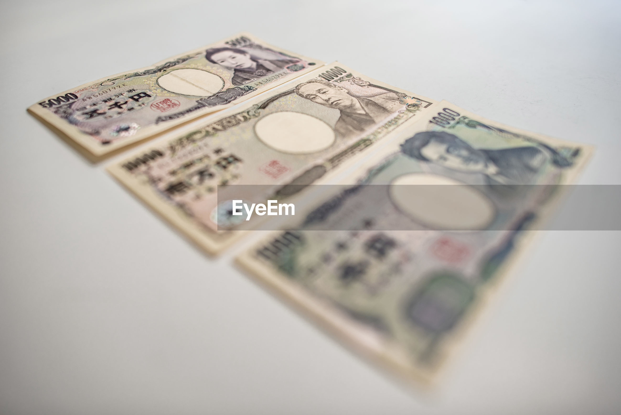 Close-up of paper currencies on white background