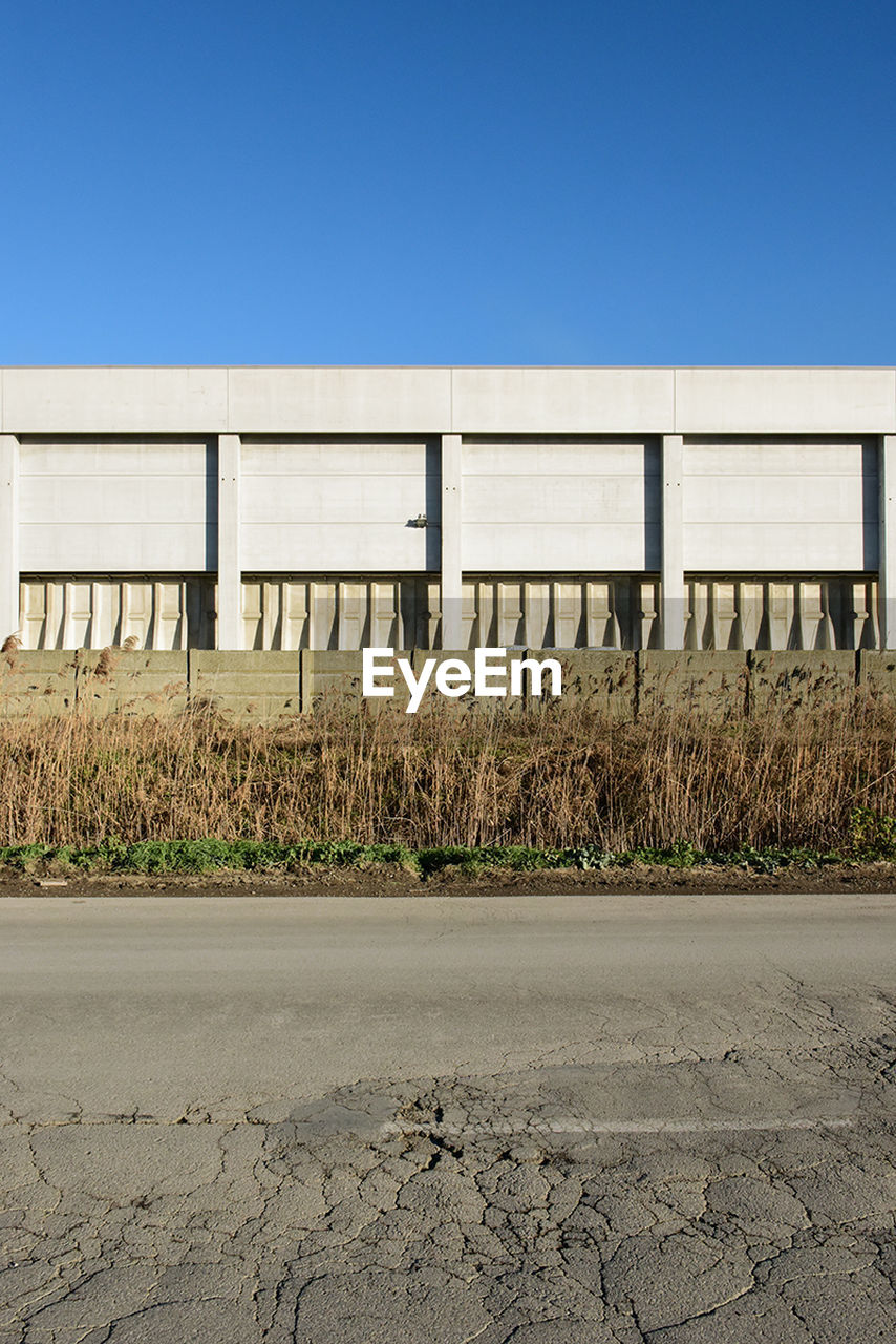 copy space, clear sky, field, day, outdoors, no people, blue, built structure, architecture, nature