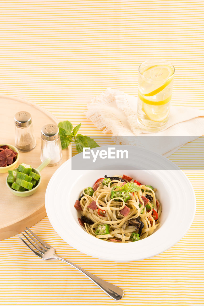 High angle view of pasta served on table