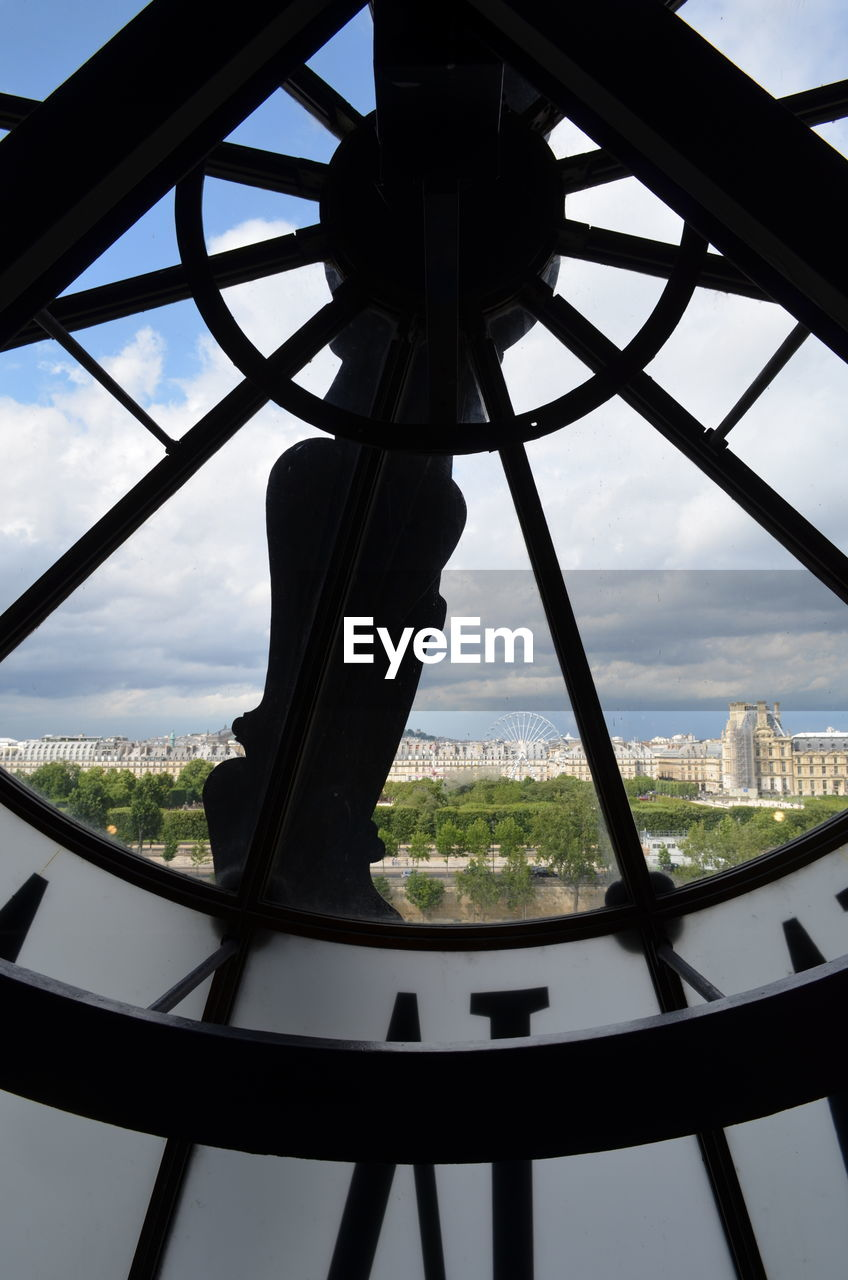 View of cityscape seen through clock