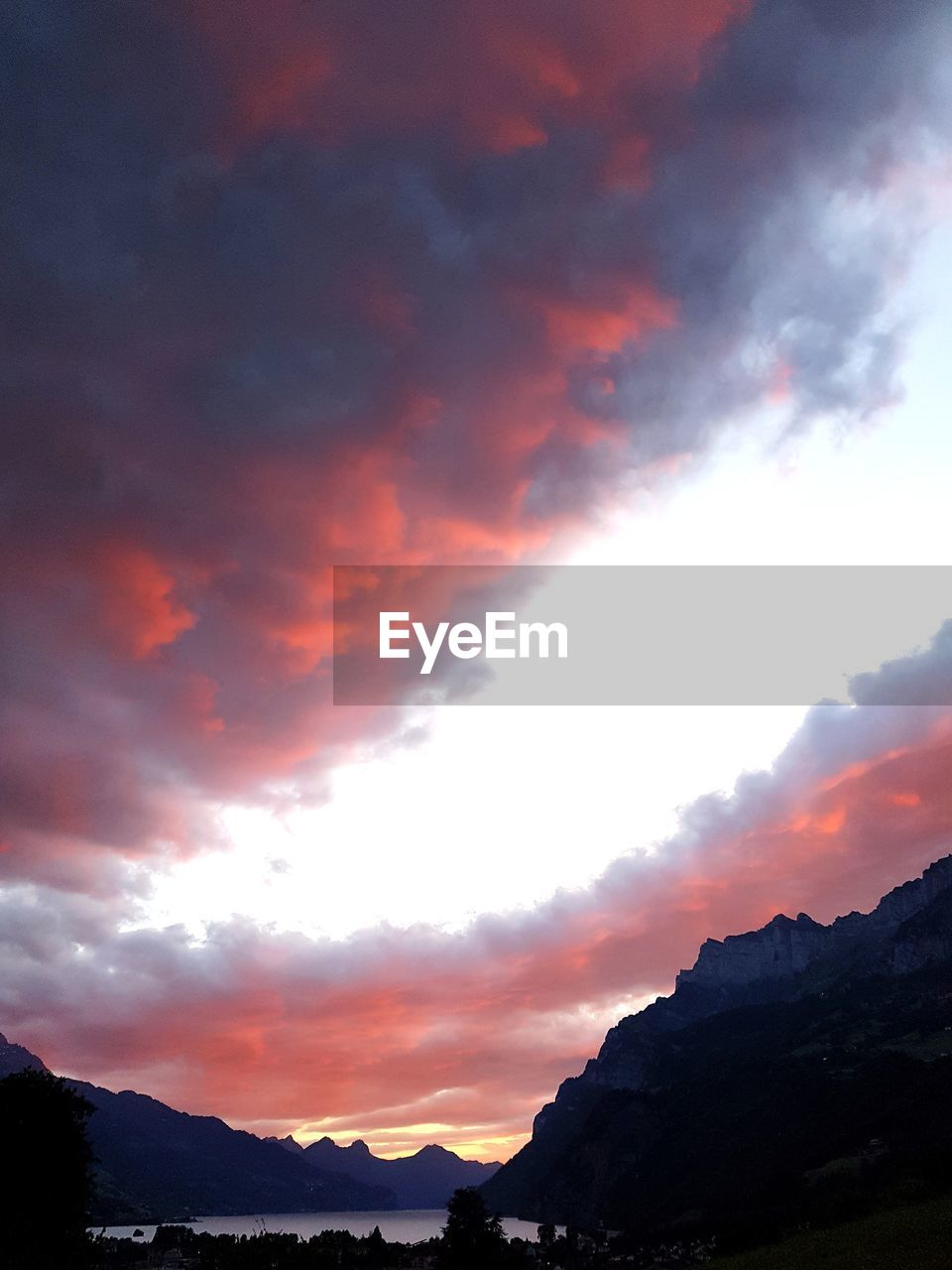 sunset, mountain, beauty in nature, nature, sky, scenics, tranquil scene, silhouette, tranquility, dramatic sky, no people, cloud - sky, outdoors, landscape, scenery, day