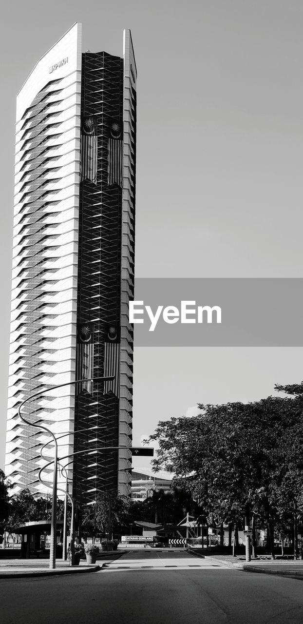 building exterior, architecture, built structure, sky, city, building, plant, nature, tree, office building exterior, modern, day, clear sky, office, no people, tall - high, street, skyscraper, transportation, low angle view, outdoors, financial district