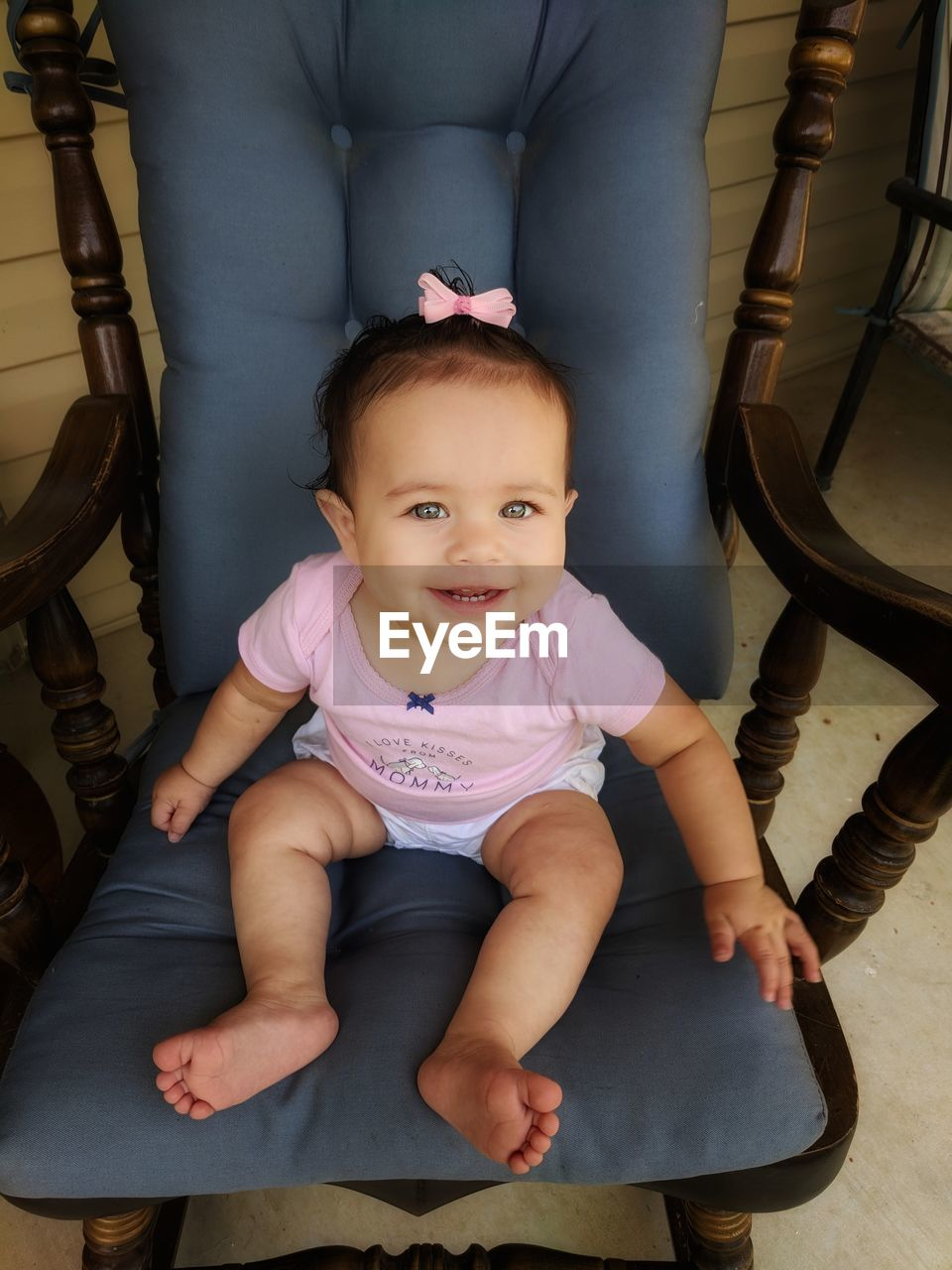 High angle portrait of cute baby girl sitting on rocking chair