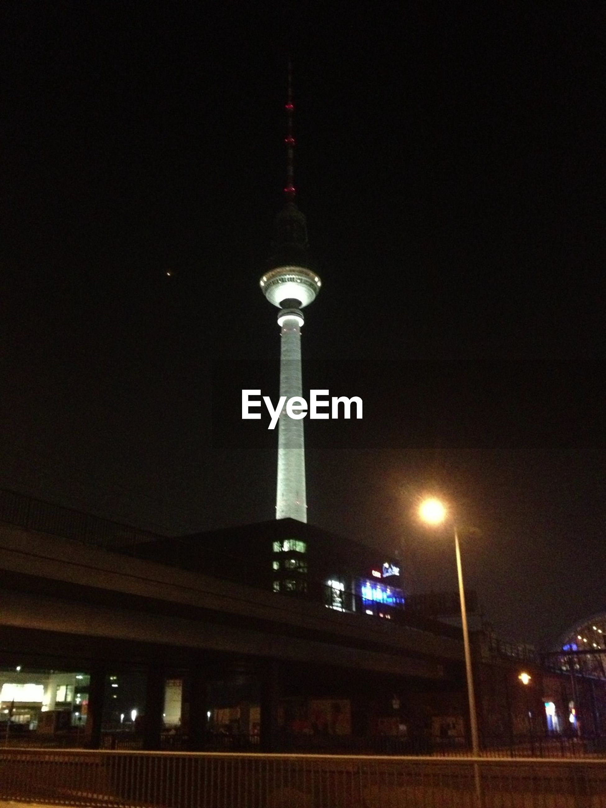 architecture, communications tower, tower, built structure, illuminated, tall - high, building exterior, night, communication, low angle view, spire, fernsehturm, international landmark, travel destinations, capital cities, city, television tower, culture, famous place, tourism
