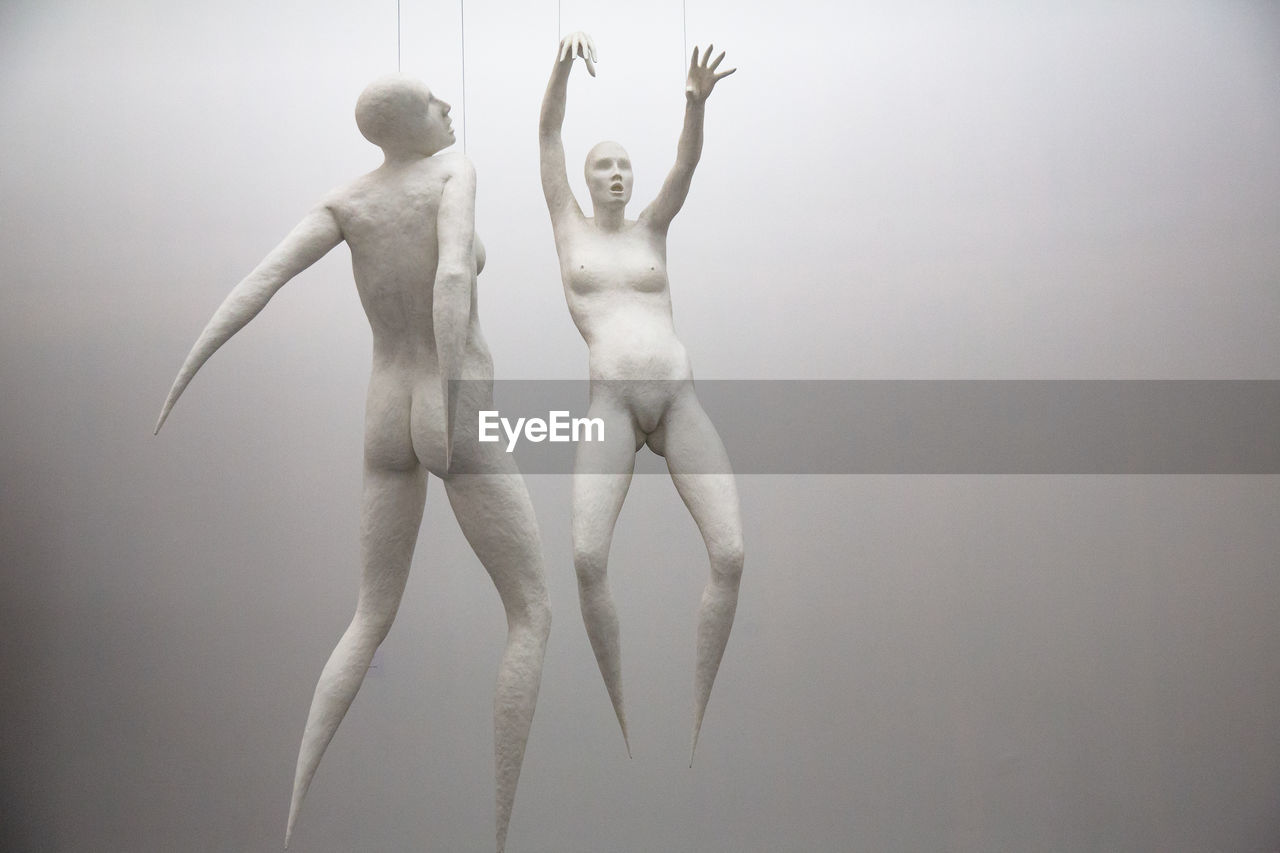 shirtless, studio shot, human arm, indoors, human representation, arms raised, limb, two people, young adult, full length, arts culture and entertainment, representation, creativity, standing, dancing, male likeness, young men, people, togetherness, human limb