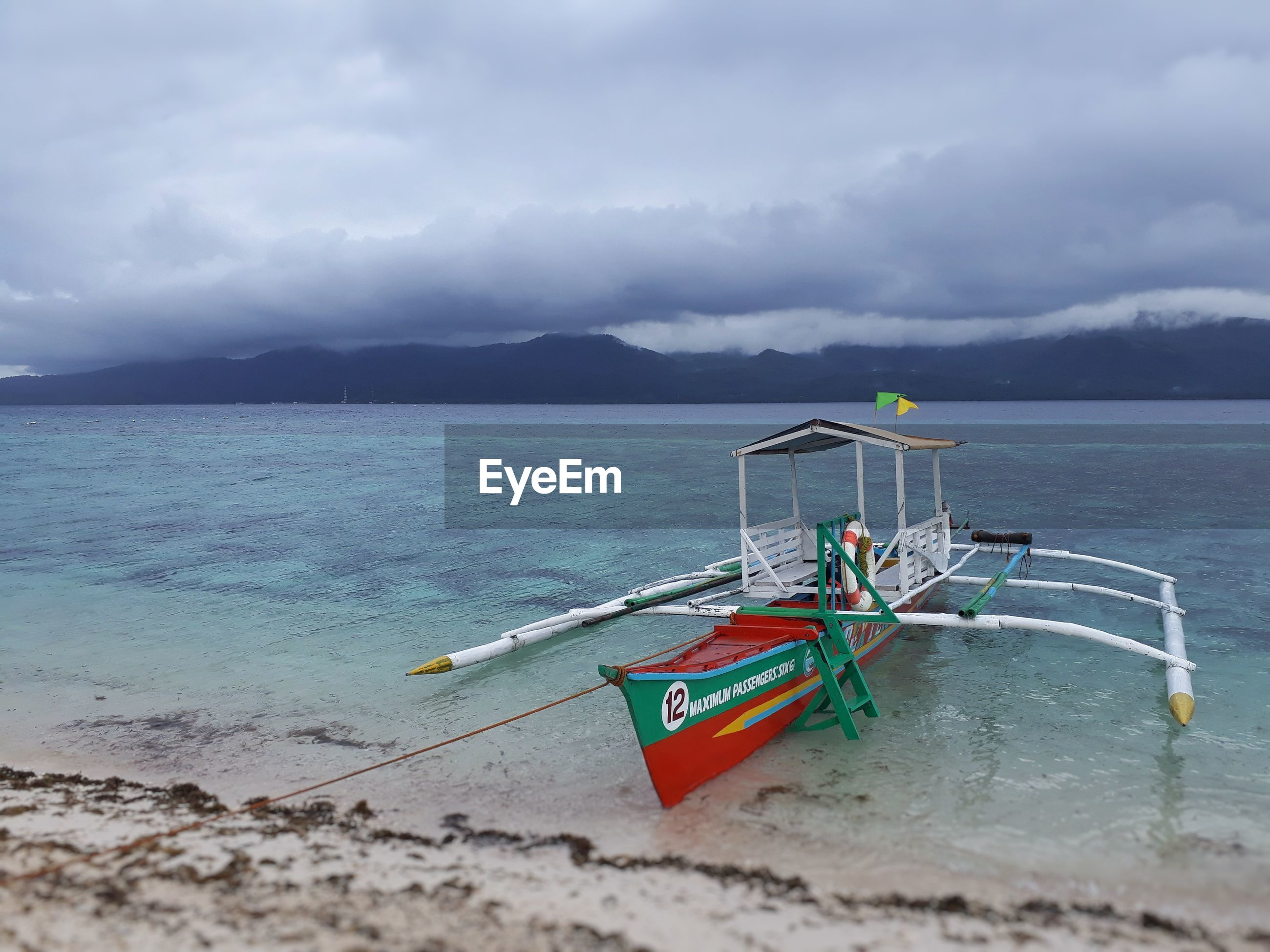 water, sea, sky, nature, cloud - sky, beauty in nature, scenics, day, nautical vessel, transportation, outdoors, horizon over water, outrigger, real people, mountain