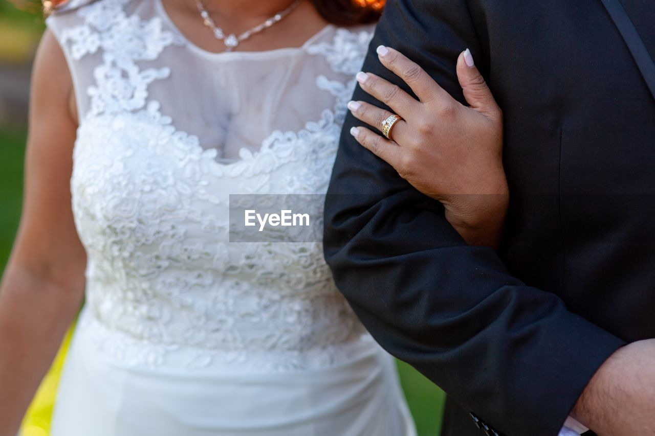 wedding, newlywed, wedding dress, bride, midsection, women, life events, event, bridegroom, celebration, two people, married, men, love, adult, couple - relationship, togetherness, standing, real people, bonding, wedding ceremony, hand, positive emotion, wife, arm around