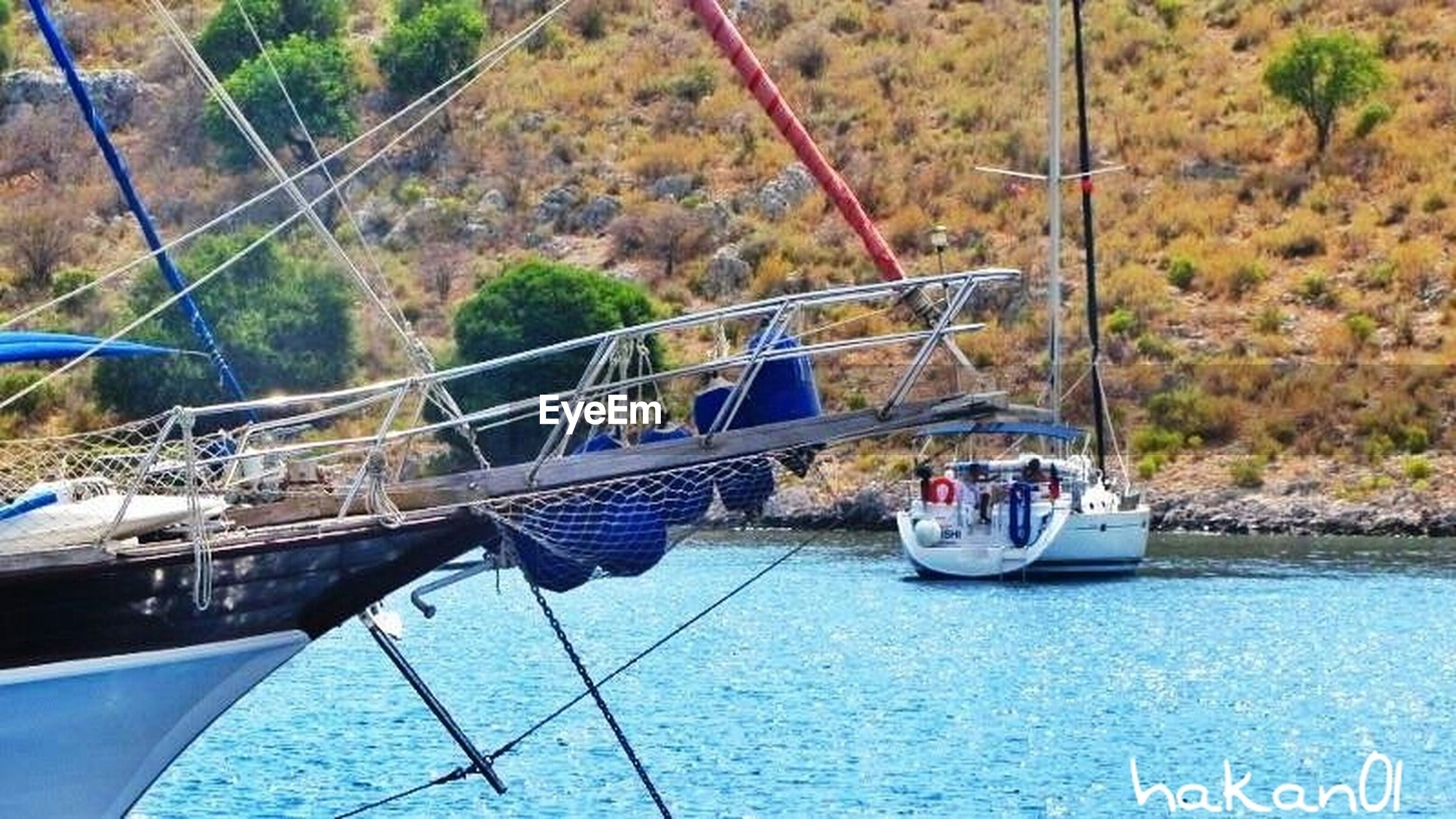transportation, nautical vessel, mode of transport, boat, water, moored, day, river, high angle view, outdoors, no people, waterfront, built structure, connection, rope, nature, travel, harbor, architecture, sunlight