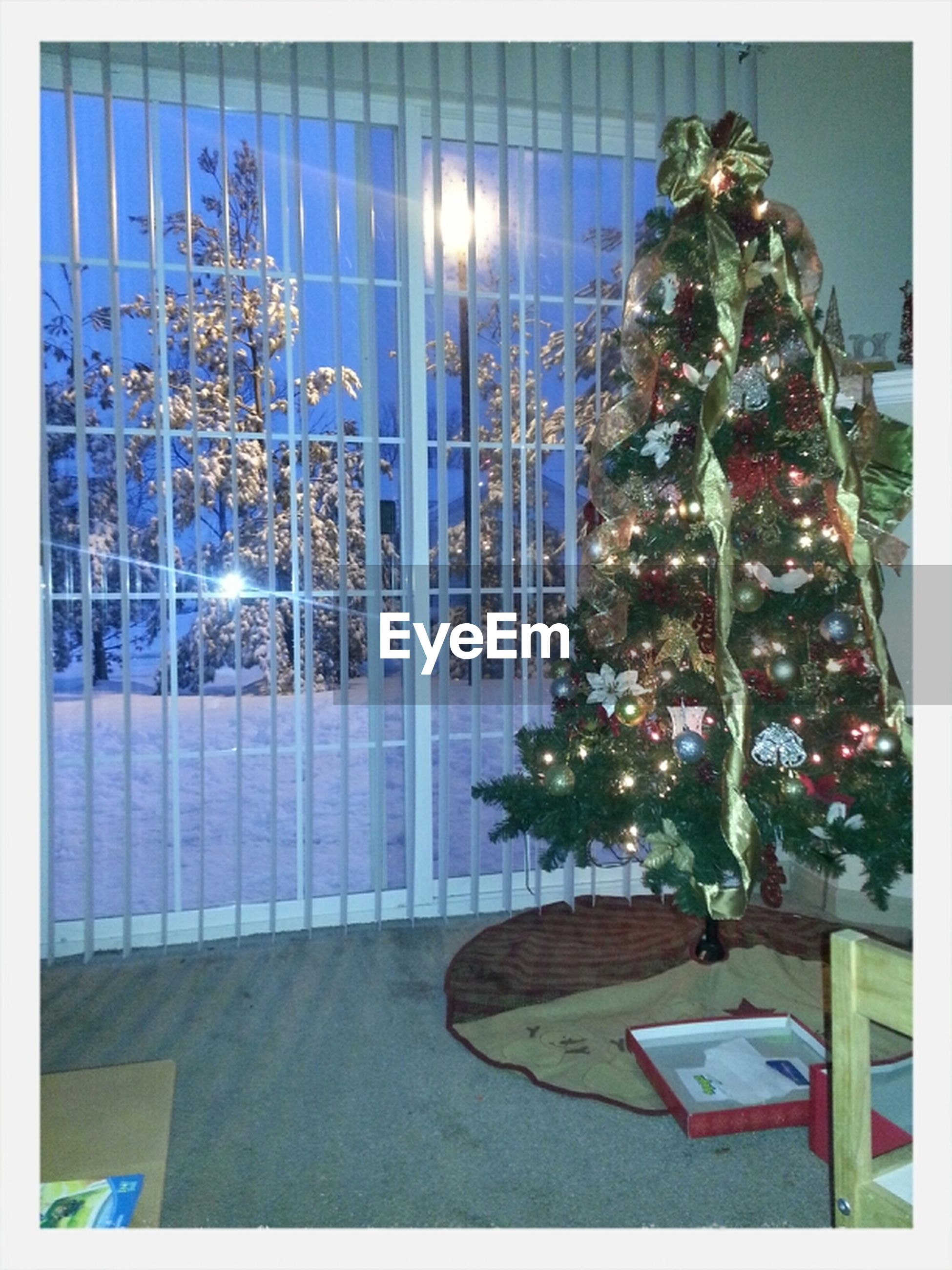 built structure, illuminated, architecture, indoors, decoration, transfer print, lighting equipment, building exterior, auto post production filter, christmas decoration, glass - material, art and craft, decor, christmas, no people, human representation, art, window, christmas tree, low angle view