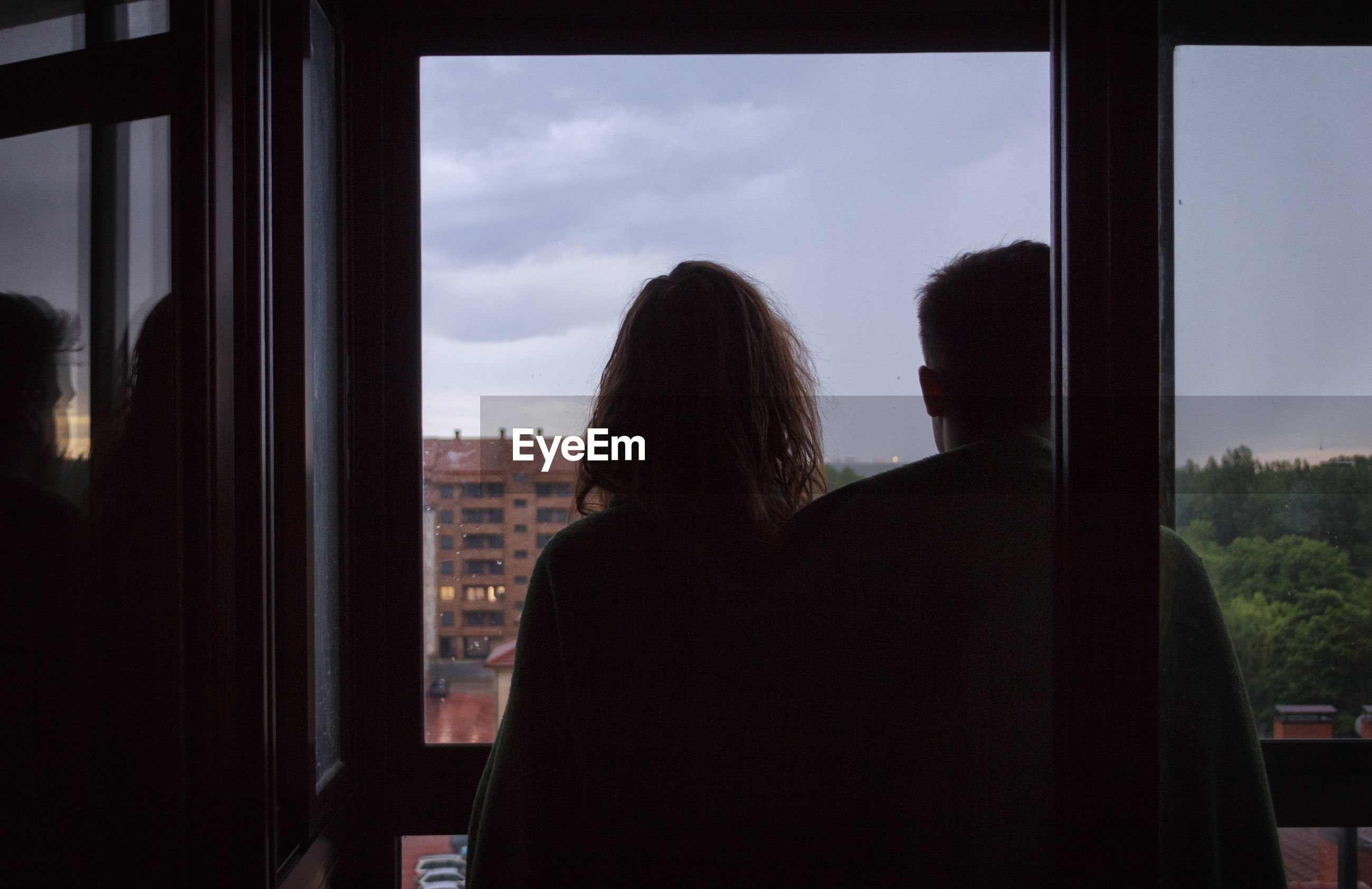 Rear view of couple standing in balcony