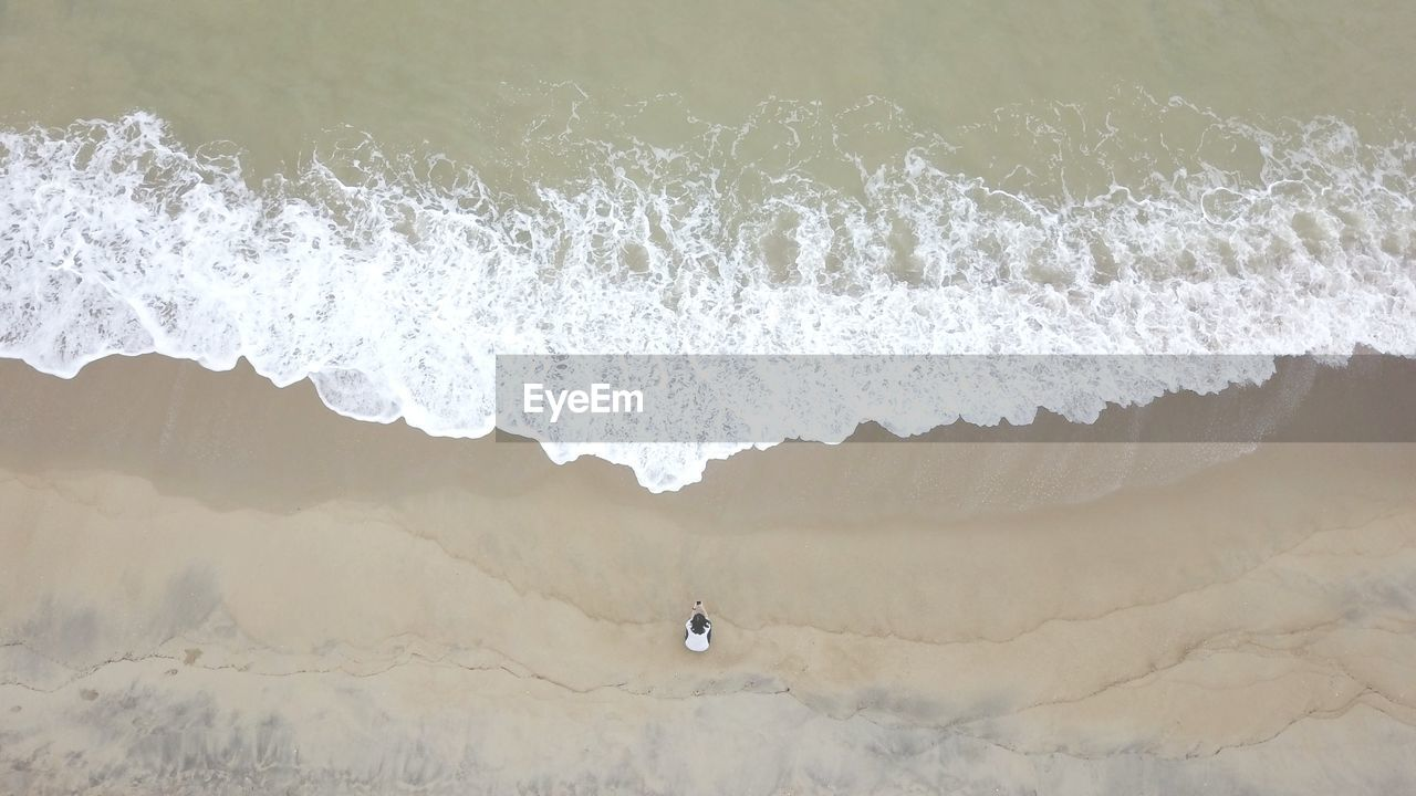 Drone View Of Woman Standing At Beach