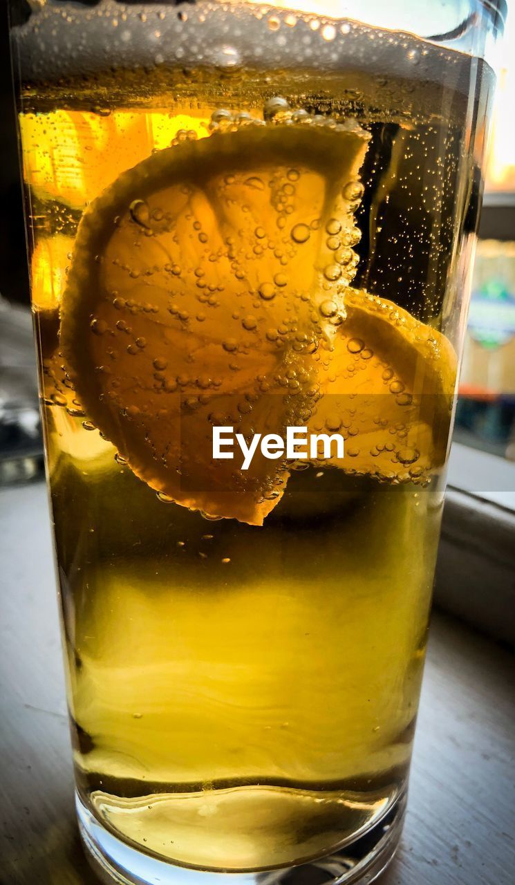 drink, food and drink, glass, refreshment, alcohol, household equipment, freshness, drinking glass, close-up, glass - material, yellow, table, still life, transparent, indoors, beer, beer - alcohol, food, focus on foreground, cold temperature, no people, beer glass