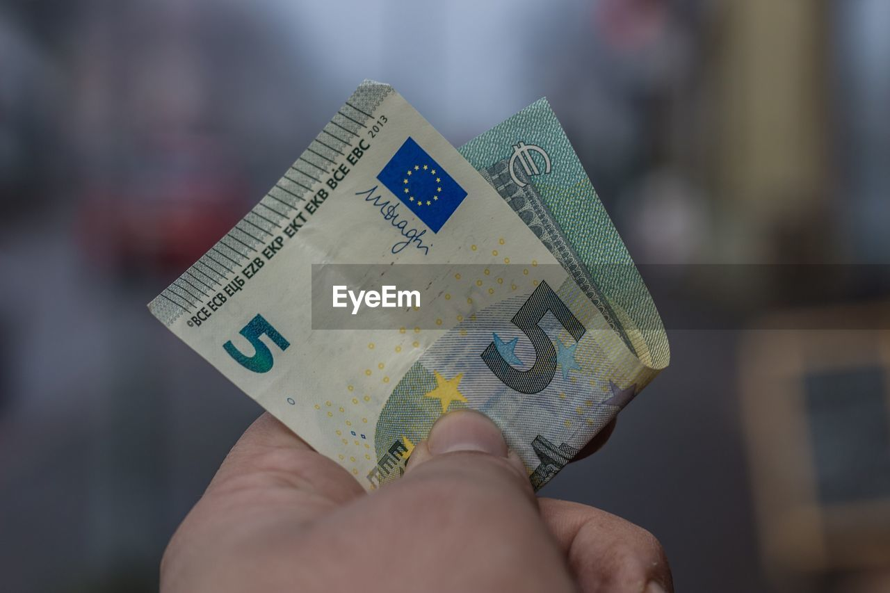 human hand, wealth, focus on foreground, currency, finance, close-up, one person, paper currency, real people, holding, indoors, human body part, savings, communication, day, people