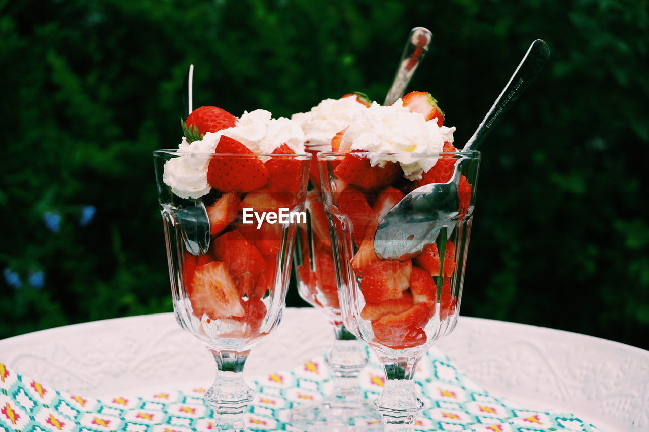 Close-Up Of Strawberries With Whipped Cream In Tray