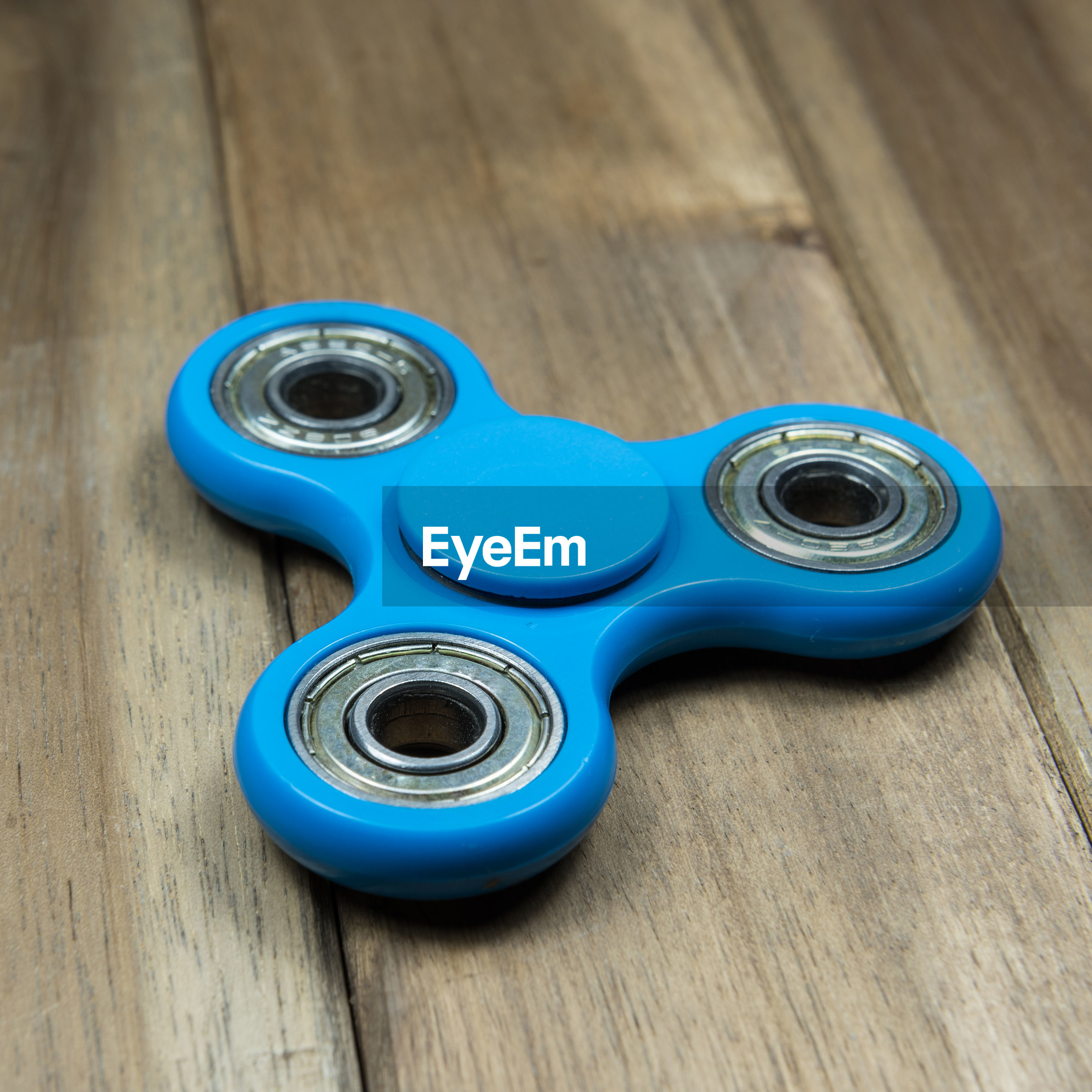 Close-up of fidget spinner on wooden table