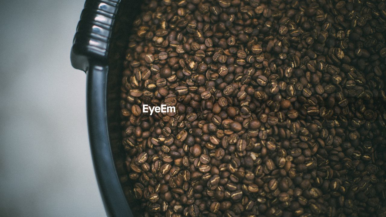 Close-Up Of Roasted Coffee Beans In Container