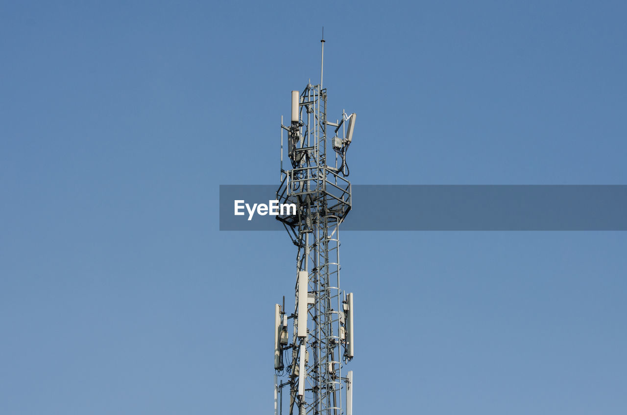 tower, low angle view, sky, technology, antenna - aerial, clear sky, satellite, communication, broadcasting, wireless technology, satellite dish, copy space, tall - high, built structure, architecture, blue, global communications, no people, telecommunications equipment, outdoors, electrical equipment