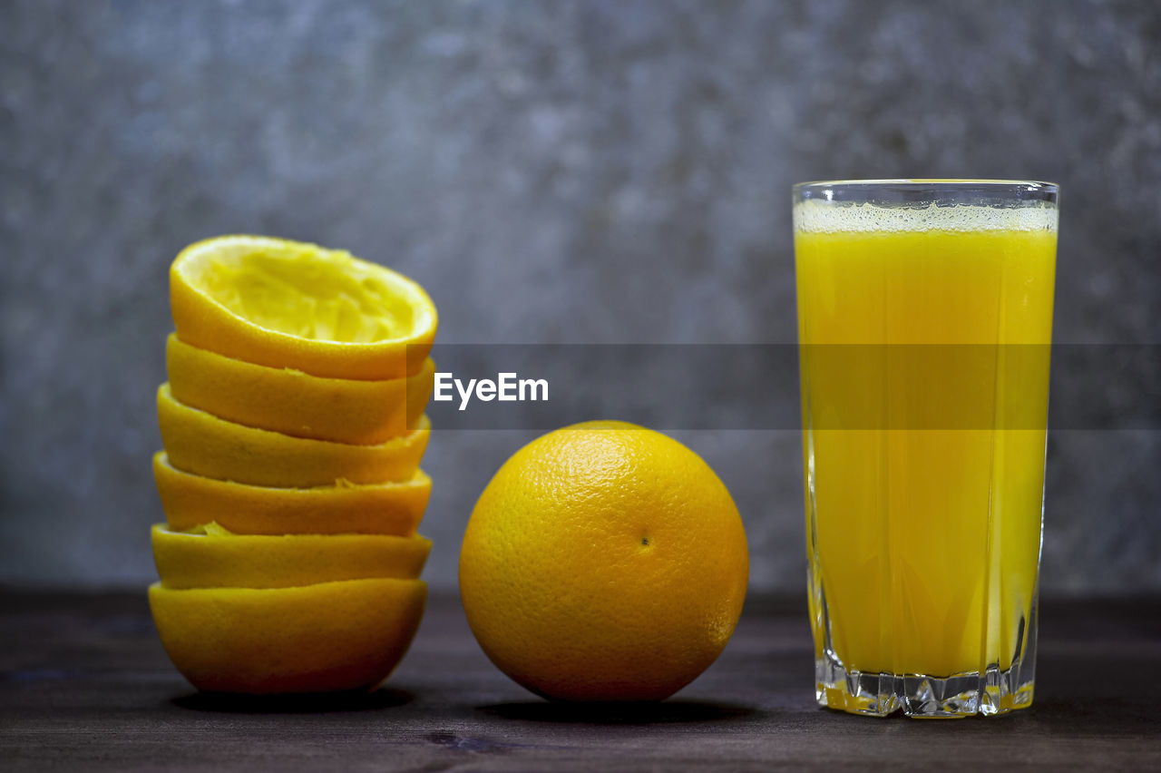 food and drink, food, drinking glass, freshness, healthy eating, glass, drink, still life, yellow, table, fruit, citrus fruit, refreshment, household equipment, wellbeing, close-up, focus on foreground, indoors, no people, orange