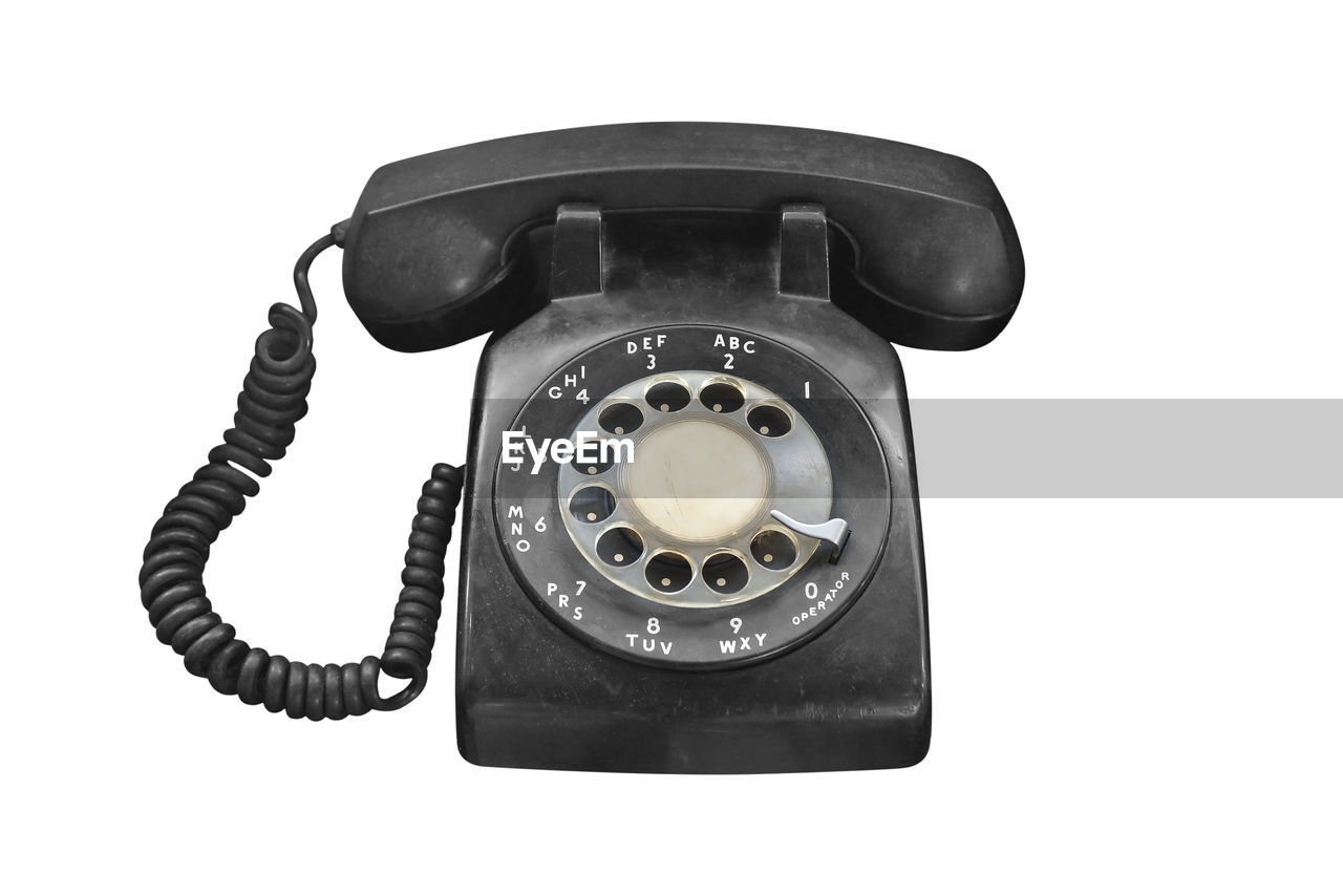 telephone, technology, retro styled, connection, landline phone, communication, white background, telephone receiver, number, no people, single object, indoors, old, close-up, antique, rotary phone, the past, history, cut out, vintage, phone cord, telephone line
