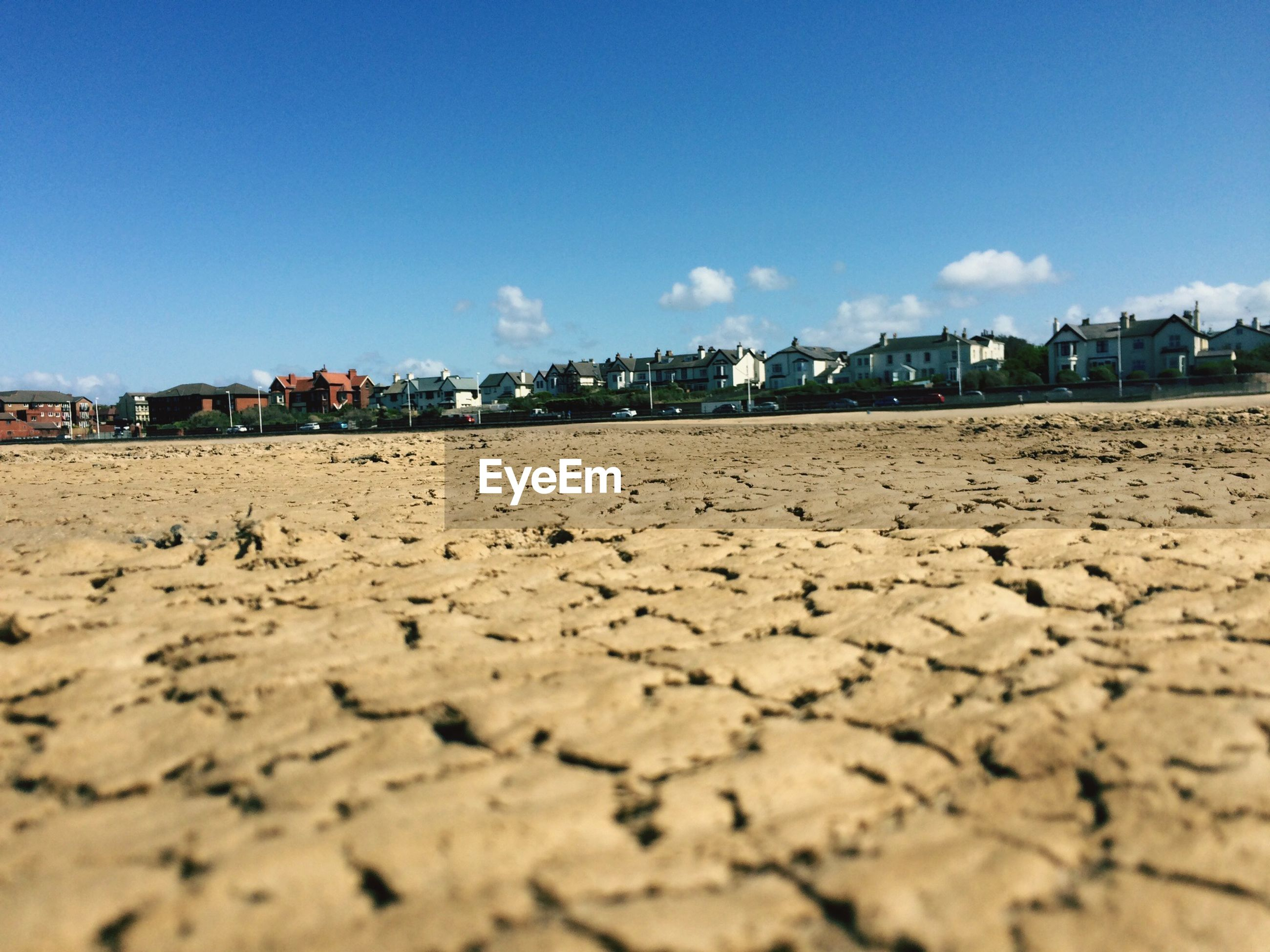 Surface level of hoylake beach with town in background