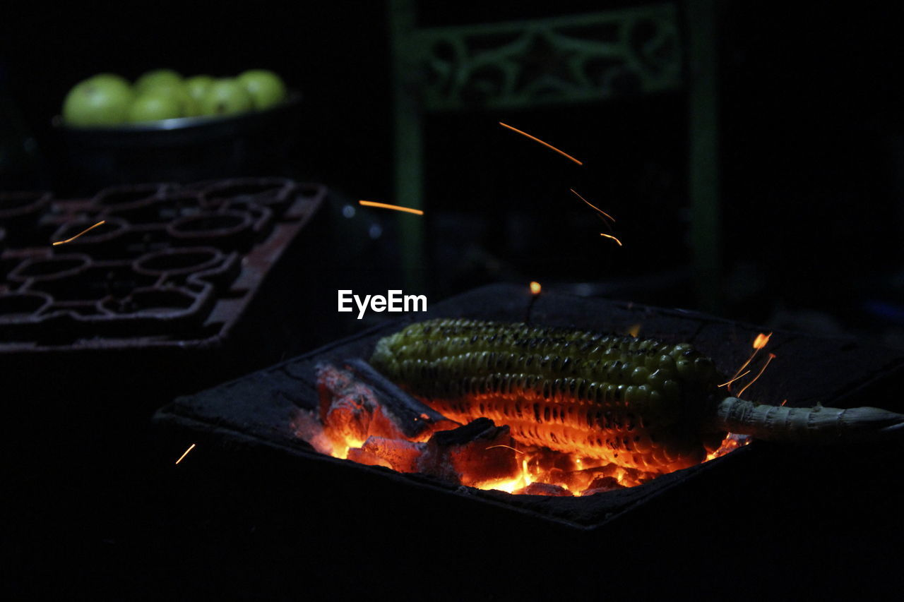 heat - temperature, burning, flame, fire, fire - natural phenomenon, food and drink, no people, glowing, food, nature, night, barbecue, illuminated, focus on foreground, close-up, motion, indoors, event, freshness