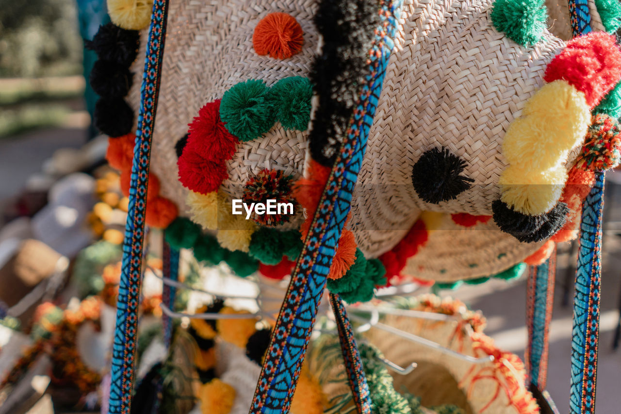 multi colored, art and craft, creativity, textile, close-up, craft, no people, for sale, wool, focus on foreground, hanging, crochet, day, retail, pattern, market, still life, indoors, full frame, retail display
