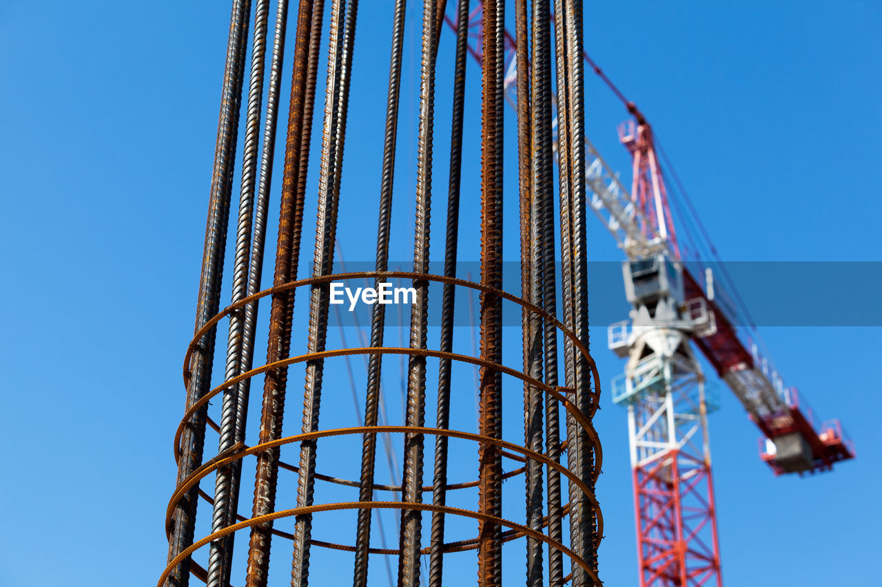 low angle view, clear sky, blue, construction site, day, no people, built structure, outdoors, architecture, building exterior, sky