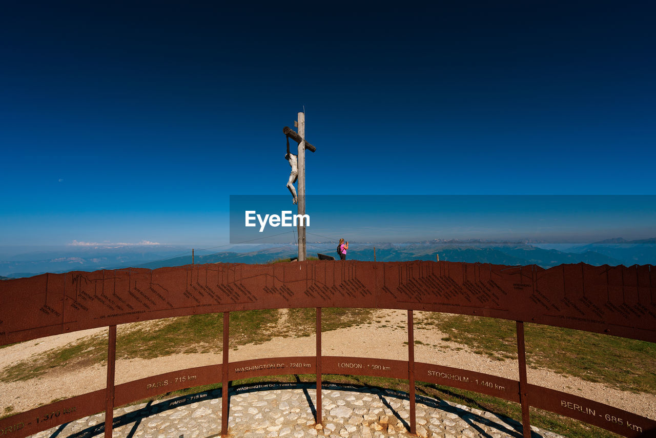 Summit cross against blue sky