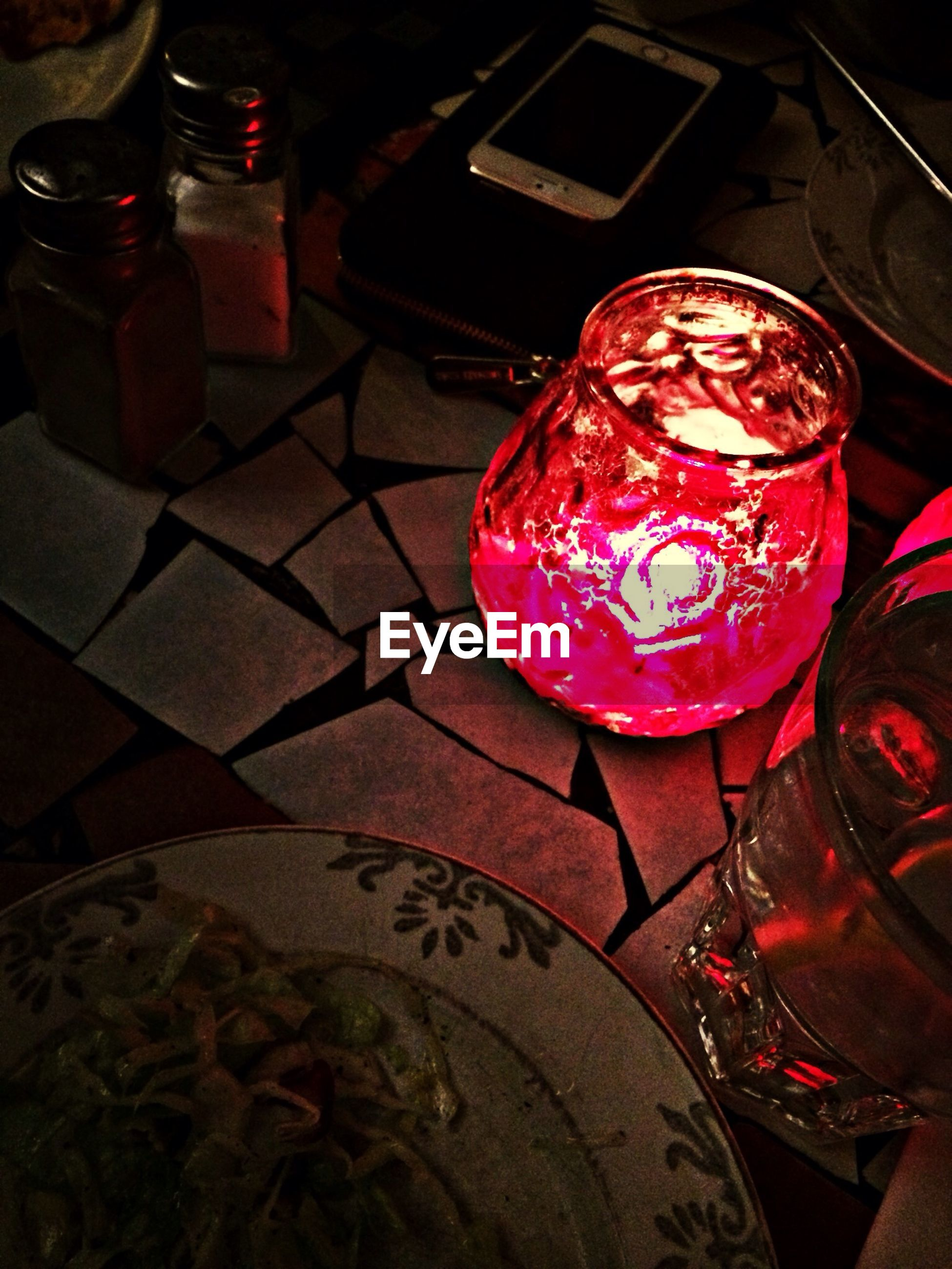 indoors, red, table, celebration, close-up, food and drink, tradition, still life, night, decoration, pink color, high angle view, glass - material, illuminated, cultures, lantern, restaurant, christmas, text
