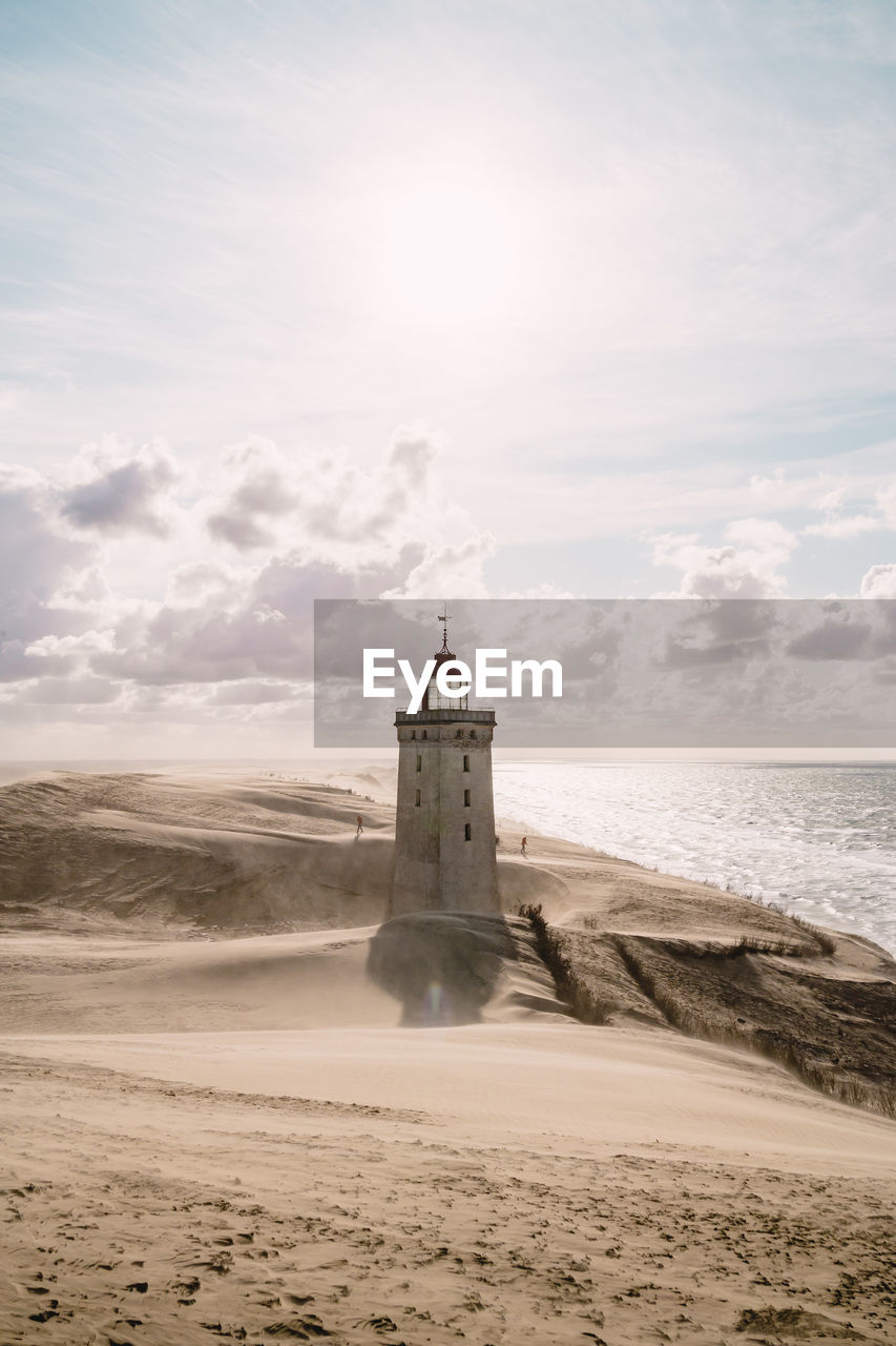 Scenic view of rubjerg knude lighthouse at seashore