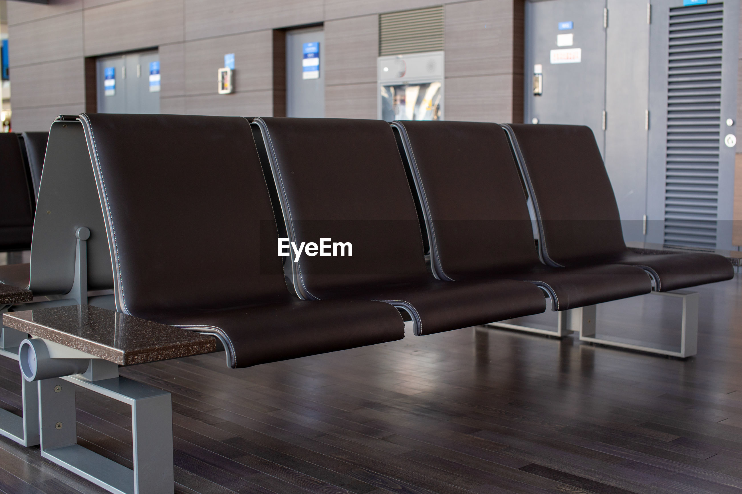 EMPTY CHAIRS AT AIRPORT