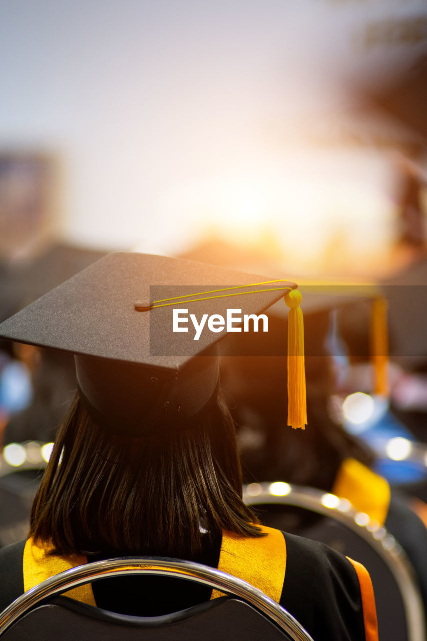Rear view of woman wearing mortarboard during graduation