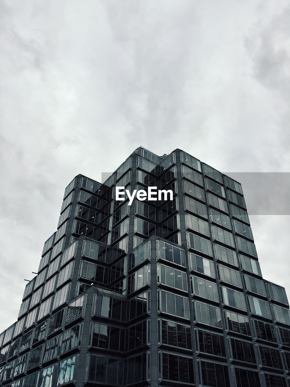 cloud - sky, sky, building exterior, architecture, low angle view, built structure, building, city, nature, modern, day, no people, office building exterior, office, outdoors, glass - material, window, tall - high, skyscraper, height