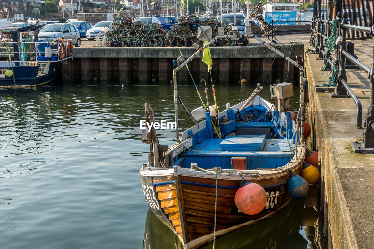 nautical vessel, water, transportation, mode of transportation, moored, day, nature, reflection, lake, no people, waterfront, outdoors, high angle view, harbor, container, architecture, travel, fishing boat, rowboat, fishing industry