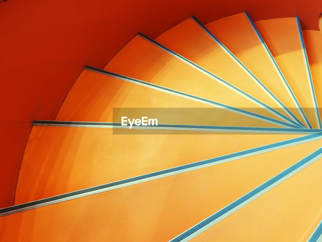 High angle view of orange spiral staircase