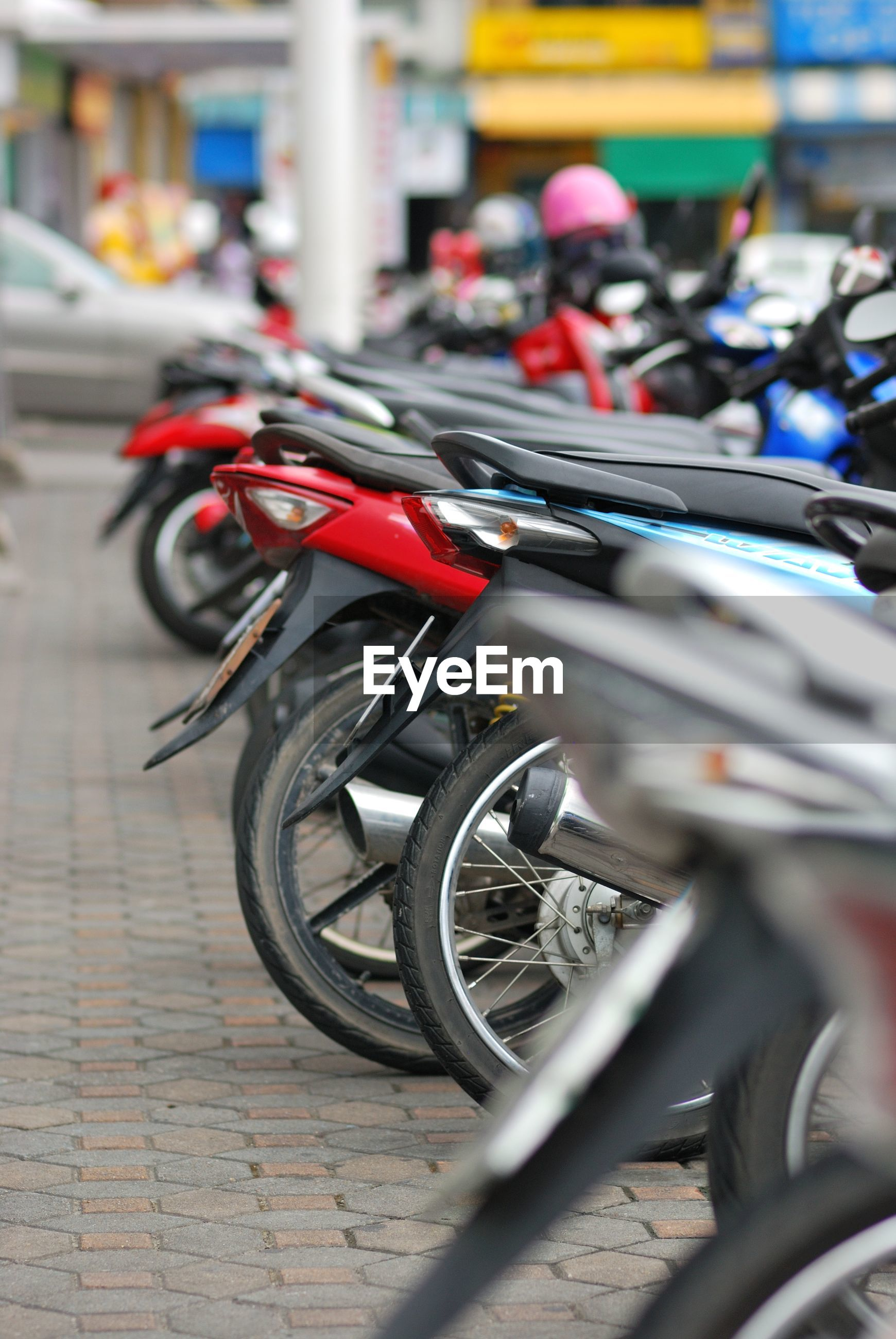 Motorcycles parked on footpath