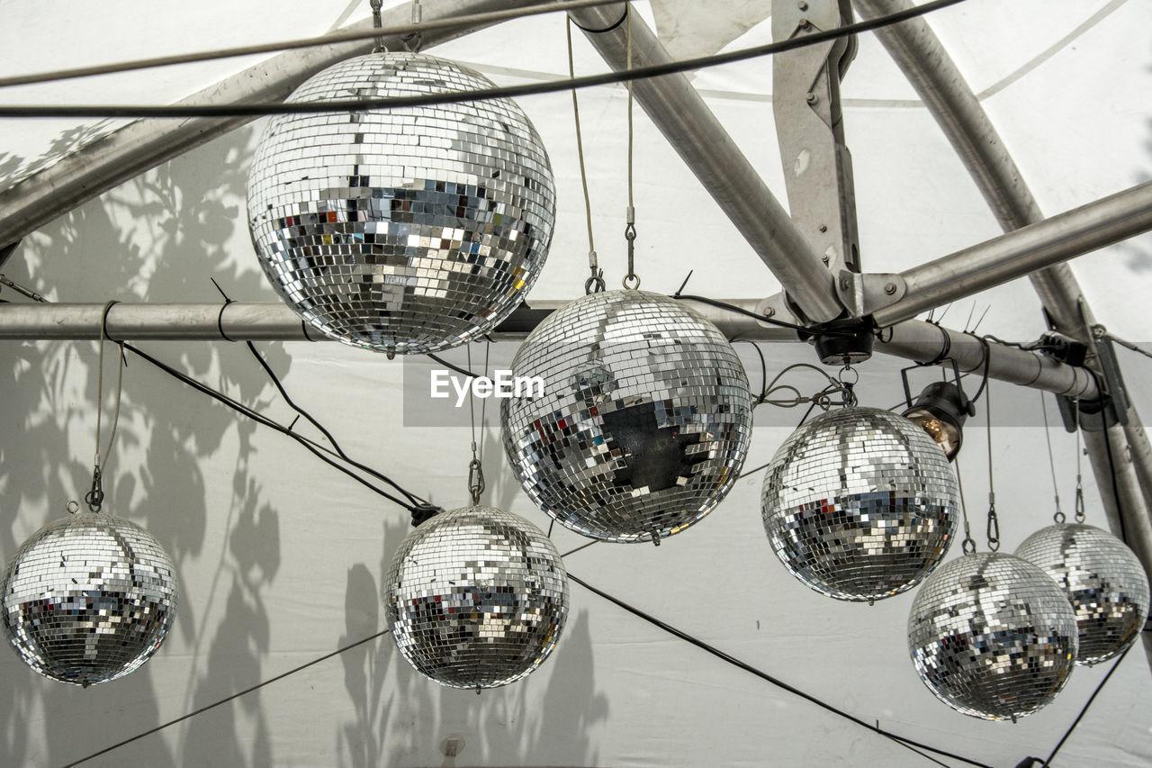 Low angle view of disco balls