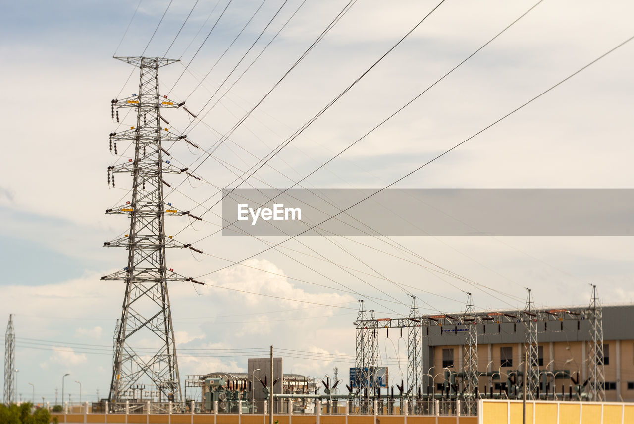 sky, connection, built structure, architecture, technology, cable, cloud - sky, power line, power supply, electricity, electricity pylon, nature, fuel and power generation, building exterior, no people, day, low angle view, metal, outdoors, industry, electrical equipment, global communications