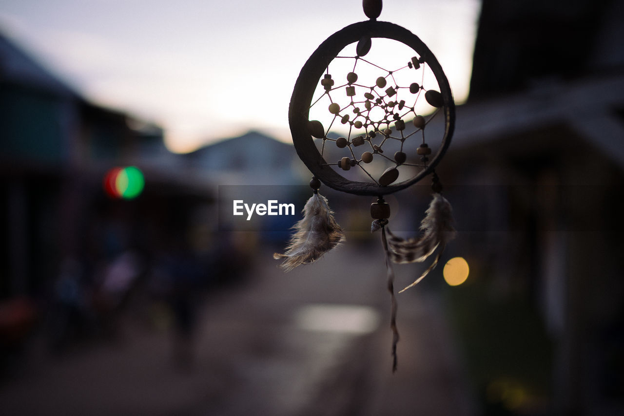 Close-Up Of Dreamcatcher Hanging During Sunset