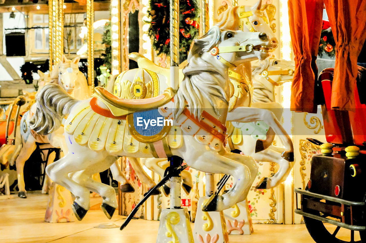 retail, store, no people, large group of objects, indoors, carousel, day