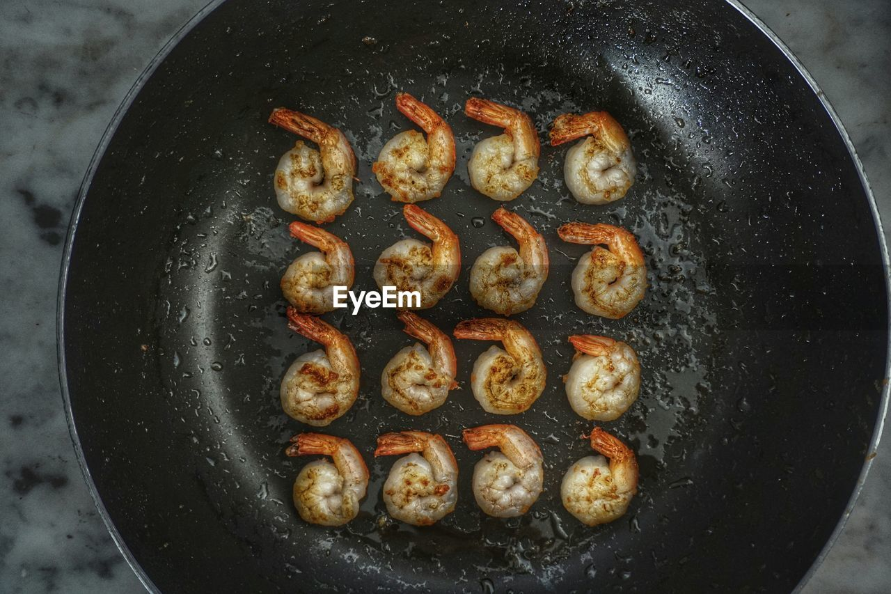 Directly Above Shot Of Prawns Frying In Pan
