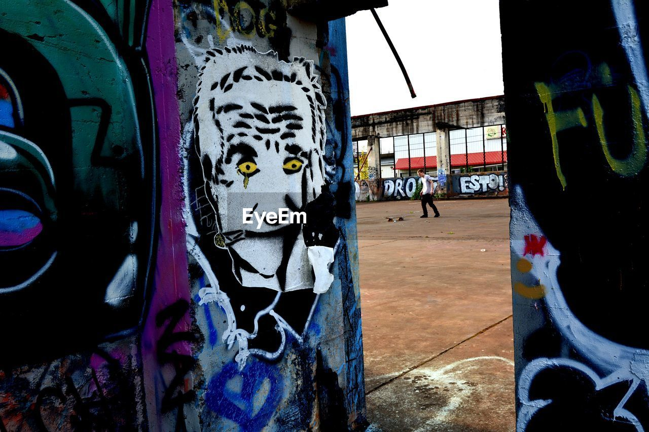 graffiti, art and craft, creativity, architecture, built structure, human representation, day, street art, building exterior, outdoors, multi colored, no people, close-up