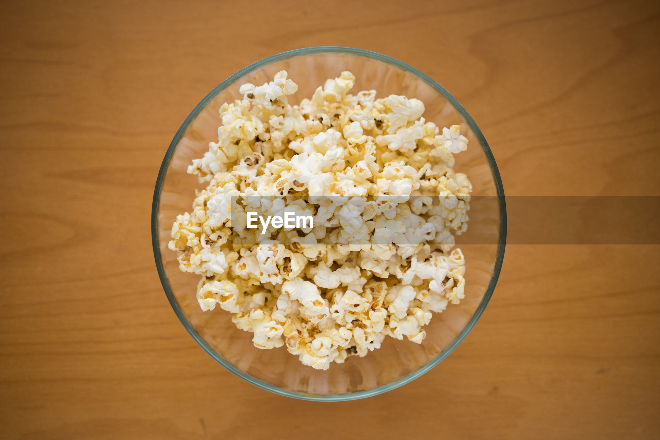 Directly above shot of popcorn in bowl on table
